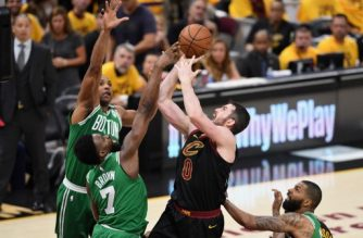 CLEVELAND, OH - MAY 19: Kevin Love #0 of the Cleveland Cavaliers shoots the ball against Jaylen Brown #7 of the Boston Celtics in the second half during Game Three of the 2018 NBA Eastern Conference Finals at Quicken Loans Arena on May 19, 2018 in Cleveland, Ohio. NOTE TO USER: User expressly acknowledges and agrees that, by downloading and or using this photograph, User is consenting to the terms and conditions of the Getty Images License Agreement.   Jason Miller/Getty Images/AFP