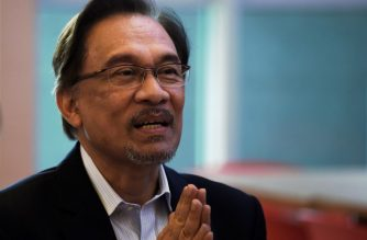 (FILES) In this file photo taken on October 31, 2014 Malaysian opposition leader Anwar Ibrahim gestures during a tea-break at the Federal courthouse in Putrajaya, outside Kuala Lumpur, Malaysia./ AFP Photo / Manan Vatsyayana