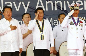 President Rodrigo Roa Duterte salutes to the Philippine flag while singing the national anthem during the Philippine Navy's 120th anniversary at the Coconut Palace of the Cultural Center of the Philippines (CCP) Complex in Roxas Boulevard, Manila on May 22, 2018. Joining the President are House Speaker Pantaleon Alvarez, Sec. Bong Go of the Office of the Special Assistant ot the President and Philippine Navy Commander Vice Admiral Robert Empredad. REY BANIQUET/PRESIDENTIAL PHOTO