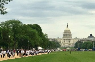 Members of the Iglesia Ni Cristo join the Worldwide Walk to Fight Poverty with the US Capitol Building in Washington DC as their backdrop. Photo by Albert Santos, Eagle News Service.