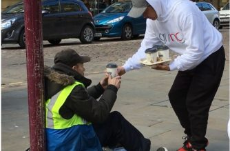 Kindness makes a difference: INC members give a cup of coffee and a helping hand to the homeless in Manchester, UK