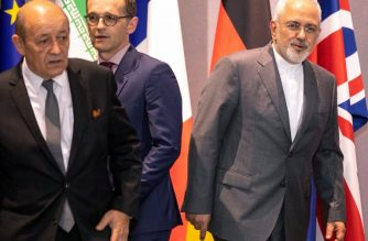 Iran's Foreign Minister Mohammad Javad Zarif (R), France's Foreign Minister Jean-Yves Le Drian (L), Germany Foreign Minister Heiko Maas (C), EU High Representative for Foreign Affairs and Britain's Foreign Secretary arrive for a meeting of EU/E3 with Iran at the EU headquarters in Brussels on May 15, 2018.   / AFP Photo / Pool / Olivier Matthys