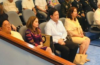 Menardo Guevarra's appointment as justice secretary was confirmed on Wednesday, May 30. In this picture, Guevarra (in white) is seen seated with newly-confirmed Tourism Secretary Bernadette Romulo-Puyat (L). /Meanne Corvera/Eagle News Service/