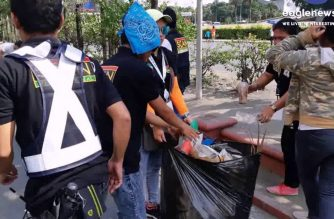 In photos:   INC members clean up Roxas Blvd immediately after #INCwalktofightpoverty