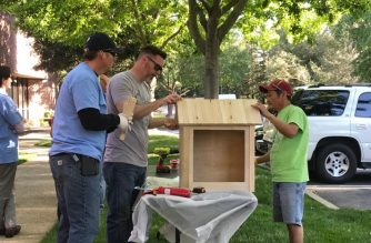 Volunteers putting together a library with available materials. Photo by Macy Membrere, EBC Sacramento Bureau.