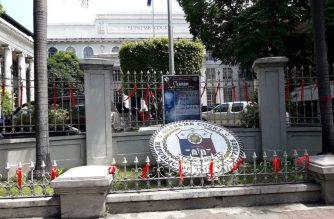 Red ribbons dot the fences and gates of the Supreme Court on Padre Faura St. in Manila on Thursday, May 10, a day before the High Court was expected to vote on the quo warranto petition filed against Chief Justice Maria Lourdes Sereno. /Moira Encina/Eagle News Service/