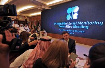 (File photo) Saudi Energy Minister Khaled al-Faleh (L) and Russian Energy Minister Alexander Novak are surrounded by reporters during a meeting of OPEC and non-OPEC members to assess compliance with production cuts and to discuss potential long-term cooperation, in Jeddah on April 20, 2018. Saudi Arabia hopes to bring Russia into the fold of an expanded club of global oil giants to sustain a stable market, leaving OPEC's role in question, analysts say. / AFP PHOTO / Amer HILABI