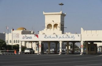 """(FILES) This file photo taken on June 23, 2017, shows a view of the Qatari side of the Abu Samrah border crossing with Saudi Arabia. The year-old acrimonious dispute between Qatar and its neighbours is forging a """"new"""" Gulf, potentially transforming what was a stable region of the Arab world, experts warn. It has shattered old alliances and rendered the six-nation Gulf Cooperation Council practically obsolete, pushing Qatar towards Turkey and Iran. / AFP PHOTO / KARIM JAAFAR"""