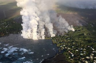 """This image obtained June 5, 2018, from the US Geological Survey (USGS) shows shows the lava flow originating from Fissure 8 (not visible in photograph) entering Kapoho Bay on June 4, 2018.  / AFP PHOTO / US Geological Survey / HO / RESTRICTED TO EDITORIAL USE - MANDATORY CREDIT """"AFP PHOTO / US Geological Survey/HO"""" - NO MARKETING NO ADVERTISING CAMPAIGNS - DISTRIBUTED AS A SERVICE TO CLIENTS"""