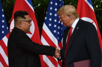 North Korea's leader Kim Jong Un (L) shakes hands with US President Donald Trump (R) after taking part in a signing ceremony at the end of their historic US-North Korea summit, at the Capella Hotel on Sentosa island in Singapore on June 12, 2018.  AFP Photo / POOL / Anthony Wallace
