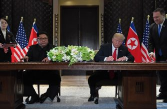 US President Donald Trump (2nd R) and North Korea's leader Kim Jong Un (2nd L) sign documents as US Secretary of State Mike Pompeo (R) and the North Korean leader's sister Kim Yo Jong (L) look on at a signing ceremony during their historic US-North Korea summit, at the Capella Hotel on Sentosa island in Singapore on June 12, 2018.  Donald Trump and Kim Jong Un became on June 12 the first sitting US and North Korean leaders to meet, shake hands and negotiate to end a decades-old nuclear stand-off. / AFP PHOTO / SAUL LOEB
