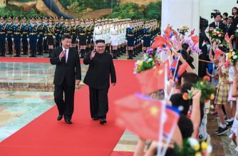 "This photograph released on June 19, 2018 by China's Xinhua News Agency, shows North Korean leader Kim Jong Un (R) and Chinese President Xi Jinping (L) waving to children after reviewing an honour guard during a welcome ceremony in Beijing's Great Hall of the People. North Korean leader Kim Jong Un briefed Chinese President Xi Jinping on June 19 on his historic summit with US President Donald Trump, a visit that underscores Beijing's efforts to remain at the centre of  fast-moving nuclear diplomacy. / AFP PHOTO / Xinhua / Shen Hong / United States OUT - United Kingdom OUT - Japan OUT - Hong Kong OUT - Germany OUT - China OUT / -----EDITORS NOTE --- RESTRICTED TO EDITORIAL USE - MANDATORY CREDIT ""AFP PHOTO /Xinhua News Agency "" - NO MARKETING - NO ADVERTISING CAMPAIGNS - DISTRIBUTED AS A SERVICE TO CLIENTS  - NO ARCHIVES /"