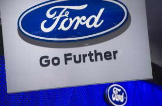 (FILES) In this file photo taken on January 10, 2017 showing the Ford logo during the 2017 North American International Auto Show in Detroit, Michigan. On June 19, 2018, Bill Ford Jr., the great-grandson of the American carmaker's founder, stood in front of thousands Tuesday in Detroit, with an abandoned train station in the background, and entwined the company's future with that of the dilapidated building behind him.  / AFP PHOTO / SAUL LOEB