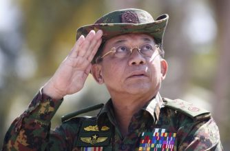 """(FILES) In this file photo taken on February 03, 2018, Myanmar military chief Senior General Min Aung Hlaing salutes during military exercises in the Ayeyarwaddy delta region. Myanmar's military chief and other top brass have been accused by Amnesty International of crimes against humanity for overseeing a """"systematic"""" attack against Rohingya Muslims, according to a report by the rights group on June 27 calling for prosecution at the International Criminal Court. / AFP PHOTO / POOL / STR"""