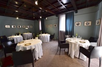 "This picture taken on July 7, 2016 shows tables in the ""Osteria Francescana"" restaurant in Modena. Massimo Bottura's obsession with cooking instead has paid off: his restaurant, the Osteria Francescana, may have put the noses of conservative Italian chefs out of joint, but it now boasts the title ""best in the world"". Set in the heart of Modena in northern Italy, the Osteria already boasted three Michelin stars before it snapped up first prize at the World's 50 Best Restaurants Awards in June thanks to a creative cuisine that reinvents Italian traditional dishes. / AFP PHOTO / GIUSEPPE CACACE"