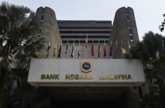 The headquarters of Bank Negara Malaysia is pictured in Kuala Lumpur on August 12, 2016. Malaysia's economic growth eased in the second quarter, the central bank said on August 12, attributing the slowdown to a decline in exports amid subdued global demand. / AFP PHOTO / MOHD RASFAN