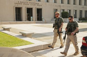 WASHINGTON, DC - JULY 02: U.S. Marshals patrol the outside of the Prettyman Federal Court Court where Ahmed Abu Khattala, one of the suspected ringleaders of the 2012 attacks in Benghazi, Libya, is being held before his pretrial detention hearing July 2, 2014 in Washington, DC. Abu Khattala was seized June 15 in Libya by U.S. Special Operations forces, 21 months after U.S. Ambassador Chris Stevens and three other Americans were killed during an attack on U.S. facilities in Benghazi.   Chip Somodevilla/Getty Images/AFP