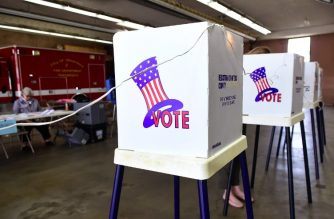 A woman casts her vote at a polling station inside the Alhambra Fire Department in Alhambra, Los Angeles County, California on June 5, 2018 as Californians go to the polls today to vote on key primary elections. / AFP Photo / Frederic J. Brown