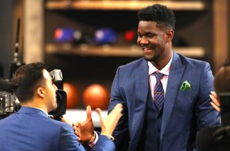 Deandre Ayton reacts after being drafted first overall by the Phoenix Suns during the 2018 NBA Draft at the Barclays Center on June 21, 2018 in the Brooklyn borough of New York City. Mike Stobe/Getty Images/AFP