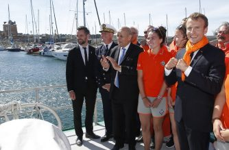 French President Emmanuel Macron (R), French Foreign Affairs Minister Jean-Yves Le Drian (3L) meet with members of the National Society of Sea Rescue (SNSM - Societe Nationale de Sauvetage en Mer) aboard an ocean rescue boat in Camaret-sur-Mer, western France, on June 21, 2018, as part of Macron's visit to the Bretagne region. / AFP Photo / POOL / Stephane Mahe