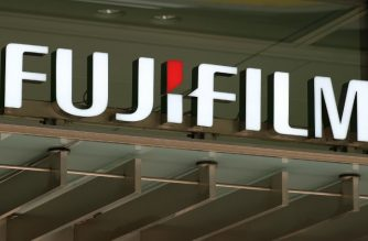 The logo of Japan's Fujifilm is displayed on the company's headquarters in Tokyo on May 14, 2018.  / AFP Photo/ Kazuhiro Nogi
