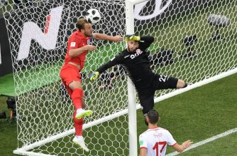 England's forward Harry Kane (L) vies for the ball with Tunisia's goalkeeper Mouez Hassen (R) during the Russia 2018 World Cup Group G football match between Tunisia and England at the Volgograd Arena in Volgograd on June 18, 2018. / AFP Photo / Nicolas Asfouri