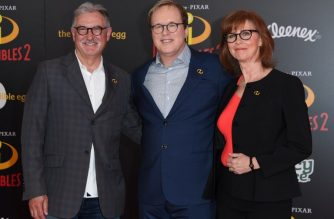 (FILES) In this file photo taken on June 5, 2018 Producer John Walker (L), director Brad Bird and producer Nicole Paradis Grindle (R) arrive at the Disney/Pixar premiere of 'The Incredibles 2' at El Capitan theatre in Hollywood. / AFP Photo / Valerie Macon
