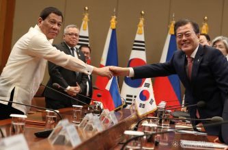 President Rodrigo Roa Duterte and Republic of Korea President Moon Jae-in shake hands prior to the start of the bilateral meeting at the Blue House in Seoul on June 4, 2018. Also in the photo are Trade and Industry Secretary Ramon Lopez and Agriculture Secretary Emmanuel Piñol. TOTO LOZANO/PRESIDENTIAL PHOTO