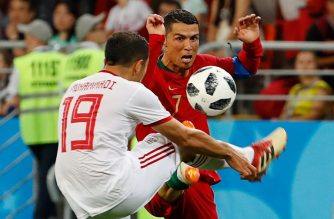 Portugal's forward Cristiano Ronaldo (R) vies for the ball with Iran's defender Majid Hosseini during the Russia 2018 World Cup Group B football match between Iran and Portugal at the Mordovia Arena in Saransk on June 25, 2018. / AFP Photo / Jack Guez