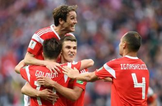 Russia's midfielder Aleksandr Golovin (L bottom) celebrates scoring his team's fifth goal with Russia's defender Mario Fernandes (top), Russia's midfielder Roman Zobnin (2R) and Russia's defender Sergey Ignashevich (R) during the Russia 2018 World Cup Group A football match between Russia and Saudi Arabia at the Luzhniki Stadium in Moscow on June 14, 2018. / AFP Photo / Patrik Stolllarz