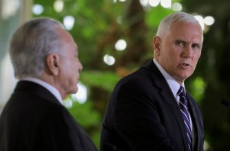 US Vice President Mike Pence (R) speaks next to Brazilian President Michel Temer (L) during a press statement at Itamaray Palace, in Brasilia on June 26, 2018. / AFP Photo / Sergio Lima