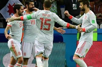 Diego Costa celebrates with his teammates after shooting the winning goal against Iran. /AFP/
