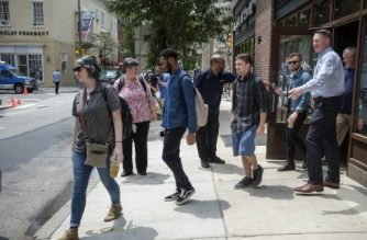 (File photo) Employees leave from the Spruce Street Starbucks store on May 29, 2018 in Philadelphia, Pennsylvania.  Starbucks is closing more than 8,000 stores across the United States Tuesday to conduct employee training on racial bias, a closely watched exercise that spotlights lingering problems of discrimination nationwide. Starbucks announced its own training on April 17 as it battled to contain outrage over the arrest of two young black men at the Philadelphia store. / AFP PHOTO / KENA BETANCUR