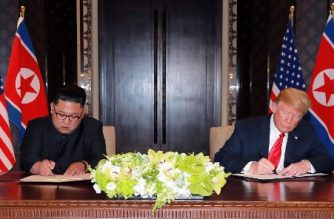 In this picture taken on June 12, 2018 and released from North Korea's official Korean Central News Agency (KCNA) on June 13, 2018, US President Donald Trump (R) and North Korea's leader Kim Jong Un (L) sign documents at a signing ceremony during their historic US-North Korea summit, at the Capella Hotel on Sentosa island in Singapore. / AFP PHOTO / KCNA VIA KNS /