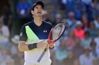(FILES) In this file photo taken on June 27, 2018 Britain's Andy Murray reacts during a Men's singles second round match against Britain's Kyle Edmund at the ATP Nature Valley International tennis tournament in Eastbourne, southern England. Andy Murray has withdrawn from Wimbledon on July 1, 2018 on the eve of the tournament after the two-time champion decided he wasn't fit enough to compete at the All England Club. / AFP PHOTO / Glyn KIRK