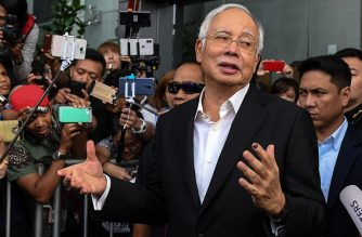 This file photo taken on May 24, 2018 shows Malaysia's former prime minister Najib Razak speaking to the media after being questioned at the Malaysian Anti-Corruption Commission (MACC) office in Putrajaya. Former Malaysian Prime Minister Najib Razak was arrested by anti-corruption investigators on July 3, 2018, a security source said.  / AFP PHOTO / Mohd RASFAN