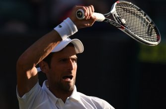 Serbia's Novak Djokovic returns against US Player Tennys Sandgren during their men's singles first round match on the second day of the 2018 Wimbledon Championships at The All England Lawn Tennis Club in Wimbledon, southwest London, on July 3, 2018. Djokovic won the match 6-3, 6-1, 6-2. / AFP PHOTO / Oli SCARFF / RESTRICTED TO EDITORIAL USE