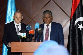 William Lacy Swing (L), the General Director of the International Organization for Migration (IOM) speaks during a news conference as the Undersecretary of the Libyan Foreign Ministry Lutfi al-Maghribi listens, in the capital Tripoli on July 5, 2018. / AFP Photo / Mahmud Turkia