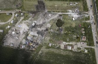 Aerial view of the site of a series of explosions at fireworks warehouses in Tultepec, central Mexico, on July 5, 2018. / AFP Photo / Pedro Pardo