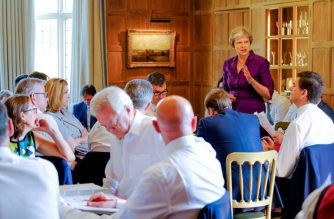 """In this handout image taken and released on July 6, 2018, by the Prime Minister's Press Office, Britain's Prime Minister Theresa May speaks to members of her cabinet at the Prime Minister's rural country residence, Chequers, west of London. British Prime Minister Theresa May sought Friday to finally unite her warring ministers behind a Brexit plan and unblock negotiations with the European Union, amid warnings she is running out of time to get a deal. / AFP PHOTO / CROWN COPYRIGHT 2018 / Joel ROUSE / RESTRICTED TO EDITORIAL USE - MANDATORY CREDIT """"AFP PHOTO / CROWN COPYRIGHT (JOEL ROUSE)"""" - NO MARKETING NO ADVERTISING CAMPAIGNS - DISTRIBUTED AS A SERVICE TO CLIENTS"""