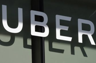(FILES) In this file photo taken on May 8, 2018 the Uber logo is seen at the second annual Uber Elevate Summit at the Skirball Center in Los Angeles, California.  / AFP Photo / Robyn Beck