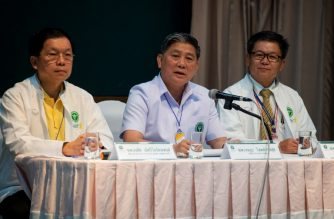General of the Public Health Ministry, Thongchai Lertwilairattanapong (L), Dr. Jesada Chokedamrongsuk (C) and director of Chiang Rai Hospital, Dr. Chaiwet Thanapaisan (R), attend a press conference at Chiang Rai Prachanukroh Hospital in Chiang Rai on July 10, 2018, as rescue operations continue for those still trapped inside the Tham Luang cave in nearby Khun Nam Nang Non Forest Park./ AFP Photo / Lillian  Suwanrumpha