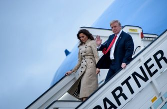 "US President Donald Trump (R) and US First Lady Melania Trump disembark from Air Force One as they arrive at Melsbroek Air Base in Haachtsesteenweg on July 10, 2018. US President Donald Trump has arrived in Brussels on the eve of a tense NATO summit where he is set to clash with allies over defence spending. Trump arrived on Air Force One at Melsbroek military airport, shortly after saying on Twitter that NATO allies should ""reimburse"" the United States for spending on the alliance.  / AFP PHOTO / Brendan Smialowski"