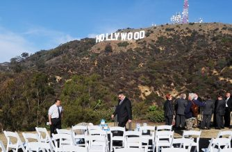 (FILES) In this file photo taken on December 4, 2012, the freshly painted Hollywood sign is seen atop the Hollywood Hills following a press conference to announce the completion of the famous landmark's major makeover./ AFP Photo / Robyn Beck
