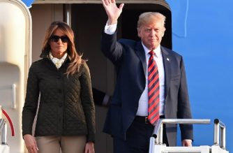 """US President Donald Trump (R) waves as he disembarks Air Force One with US First Lady Melania Trump (L) at Prestwick Airport, south of Glasgow on July 13, 2018, on the second day of Trump's UK visit. US President Donald Trump on Friday played down his extraordinary attack on Britain's plans for Brexit, praising Prime Minister Theresa May and insisting bilateral relations """"have never been stronger"""", even as tens of thousands protested in London against his visit. / AFP PHOTO / Andy BUCHANAN"""