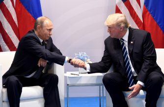 (FILES) In this file photo taken on July 07, 2017 US President Donald Trump and Russia's President Vladimir Putin shake hands during a meeting on the sidelines of the G20 Summit in Hamburg, Germany. After months of anticipation, Donald Trump and Vladimir Putin meet on Monday July 16, 2018, to put to the test the US president's ambition to forge a personal bond with the Kremlin chief.  / AFP PHOTO / SAUL LOEB