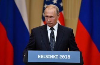 """Russia's President Vladimir Putin looks on during a joint press conference with US President after a meeting at the Presidential Palace in Helsinki, on July 16, 2018. The US and Russian leaders opened an historic summit in Helsinki, with Donald Trump promising an """"extraordinary relationship"""" and Vladimir Putin saying it was high time to thrash out disputes around the world.  / AFP PHOTO / Yuri KADOBNOV"""
