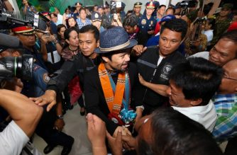 "This handout photo taken on July 16, 2018 and released by the Manny Pacquiao Promotions (MPP) shows Philippine boxing icon Manny Pacquiao (C) greeted by fans shortly after arriving from Malaysia, at a mall in General Santos City, in southern island of Mindanao, a day after knocking out Argentinian boxer Lucas Matthysse.    Pacquiao said July 16, he was good for ""two or three"" more fights, naming Terence Crawford, Vasyl Lomachenko or Floyd Mayweather as possible opponents a day after winning a new world title.  / AFP PHOTO / MPP / WENDELL ALINEA"