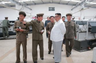 """This undated picture released by North Korea's official Korean Central News Agency (KCNA) on July 17, 2018 via KNS shows North Korean leader Kim Jong Un (2nd R) inspecting the September 1 Machine Factory under the Ranam Coal-mining Machine Complex in North Hamgyong Province. / AFP PHOTO / KCNA VIA KNS / KCNA VIA KNS /  - South Korea OUT / REPUBLIC OF KOREA OUT   ---EDITORS NOTE--- RESTRICTED TO EDITORIAL USE - MANDATORY CREDIT """"AFP PHOTO/KCNA VIA KNS"""" - NO MARKETING NO ADVERTISING CAMPAIGNS - DISTRIBUTED AS A SERVICE TO CLIENTS THIS PICTURE WAS MADE AVAILABLE BY A THIRD PARTY. AFP CAN NOT INDEPENDENTLY VERIFY THE AUTHENTICITY, LOCATION, DATE AND CONTENT OF THIS IMAGE.  /"""