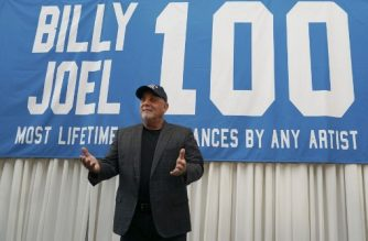 Musician Billy Joel poses under a banner at a press conference at Madison Square Garden July 18, 2018 to celebrate his achievement of 100 lifetime performances at Madison Square Garden in New York. / AFP Photo / TIMOTHY A. CLARY